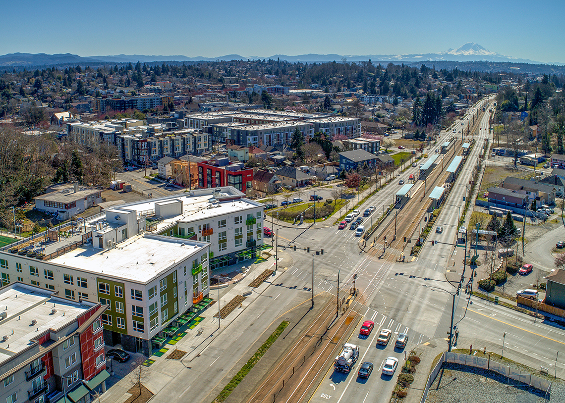 BDR Holdings Sonata Apartments at Columbia Station Built Green 4-Star exterior with mountain view and nearby light rail. Photo credit: Heiser Media