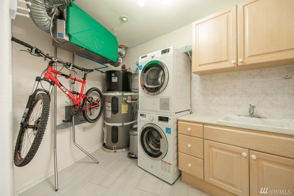 McGraw Built Green 4-Star Seattle condo remodel utility room with bike rack and heat pump hot water heater